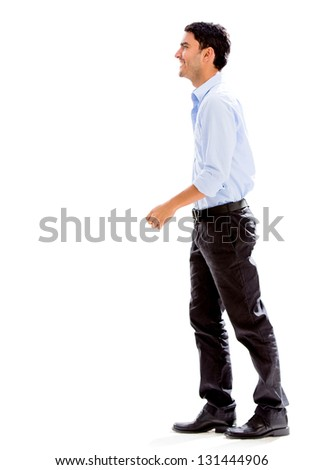 Business man walking to the side - isolated over a white background