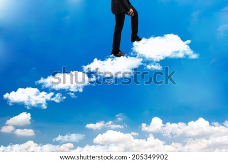 business man walking up stepping cross cloud stairs on blue sky idea concept for success and growth   - stock photo