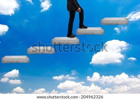 business man walking up stepping ladder on blue sky in idea concept step by step for success and growth business - stock photo
