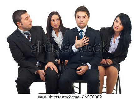 Business man were chosen and being surprised while his colleagues looking at him and being envious - stock photo