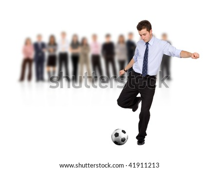 business man with a football and a group isolated over a white background - stock photo
