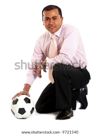 business man with a football isolated over a white background
