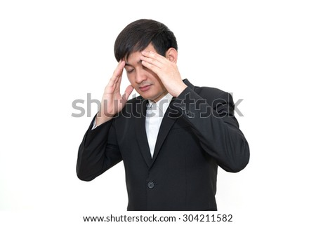 Business man with a headache, isolated over white.