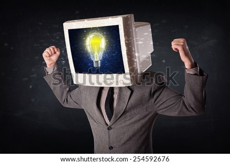 Business man with a pc monitor head and idea light bulb glowing in the display - stock photo
