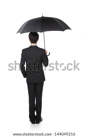 Business Man with an umbrella , isolated against white background, asian male model - stock photo