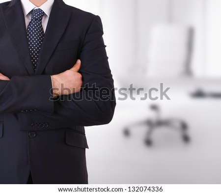 Business man with arms crossed. - stock photo