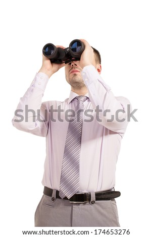 Business man with binoculars. Young businessman looking through binoculars - market research concept. Businessman in shirt and tie looking through binoculars.  - stock photo