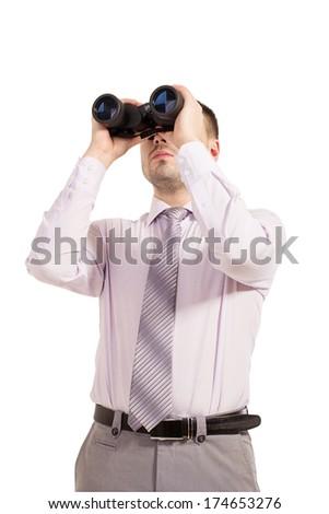 Business man with binoculars. Young businessman looking through binoculars - market research concept. Businessman in shirt and tie looking through binoculars.  - stock photo