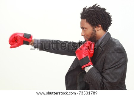 Business man with boxing gloves - stock photo
