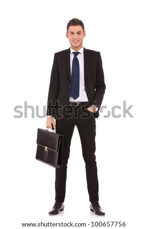 Business man with briefcase standing on white background - stock photo