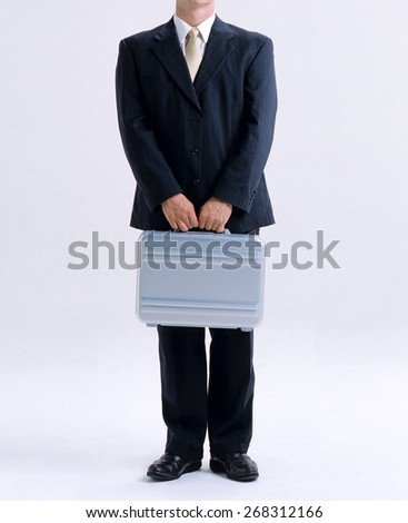 Business man with case  - stock photo