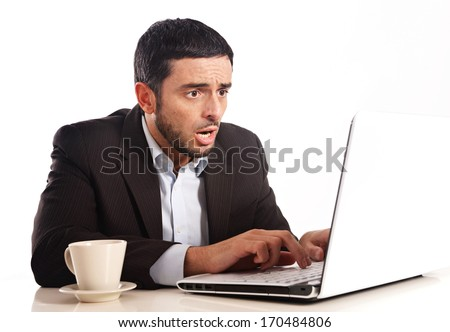 Business man with Computer overworked, stressed and desperate - stock photo