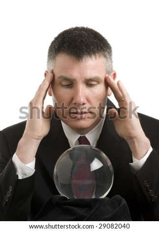 Business man with crystal ball looks for guidance - stock photo