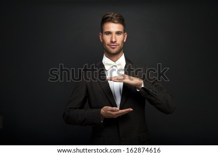 Business man with cupped hands as if holding something.  - stock photo