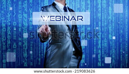 Business man with digital background pressing on button webinar - stock photo