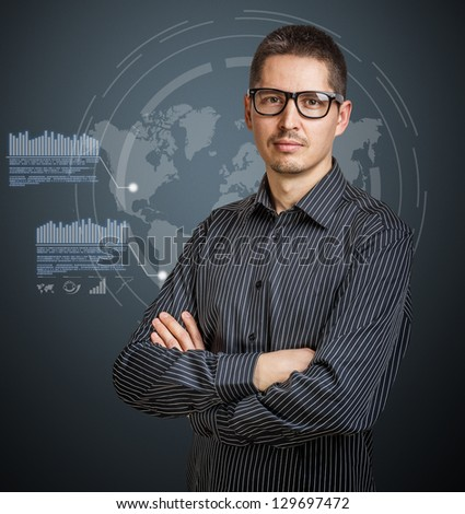 Business man with digital interface on background - stock photo