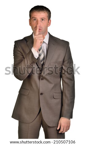 Business man with finger on lips - stock photo
