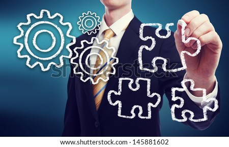 Business Man with Gears - Ideas and Puzzle Pieces - Strategy - stock photo