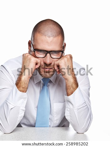 Business man with glases at the table isolated white