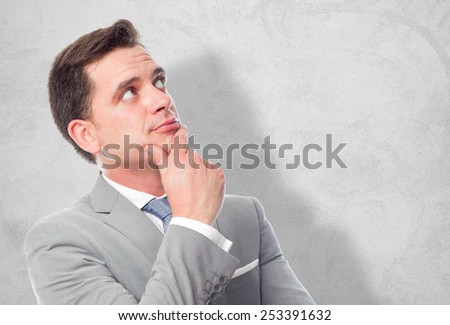 Business man with grey suit. He is paying attention. Over concrete wallpaper - stock photo