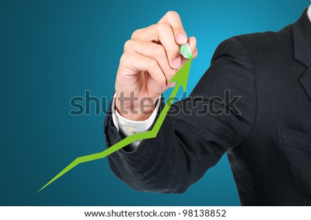 Business man with growing graph - stock photo