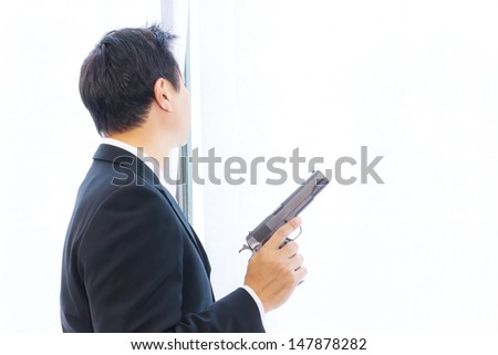 business man with gun - stock photo