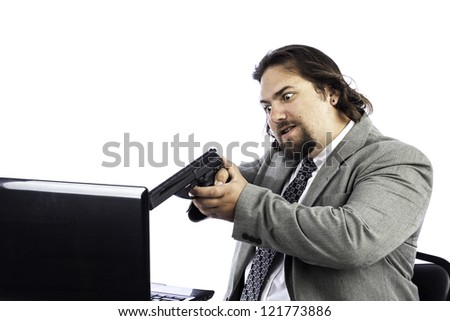 Business man with gun pointed at laptop could be used for anger or crime - stock photo