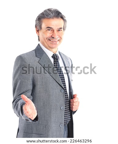 Business man with hand extended to handshake - isolated over white - stock photo
