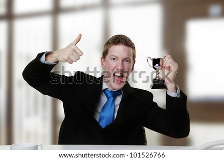 business man with his arm up in the air looking very happy about something