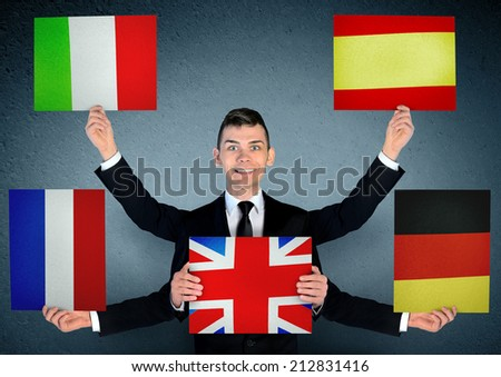 Business man with languages board - stock photo