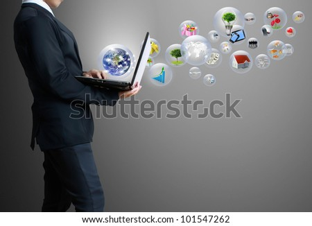 business man  with laptop .Elements of this image furnished by NASA
