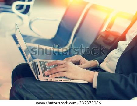 business man with laptop the morning at airport terminal - stock photo