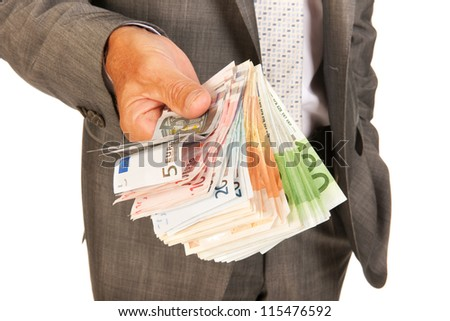 Business man with lots of Euros in banknotes