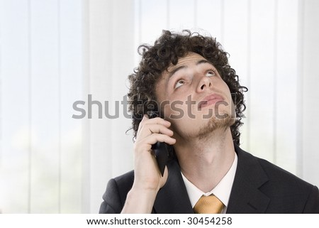 Business man with mobile phone - stock photo