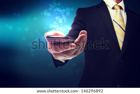 Business man with mobile phone and technology background - stock photo