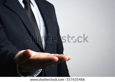 Business man with palm up for add visual effect on white background