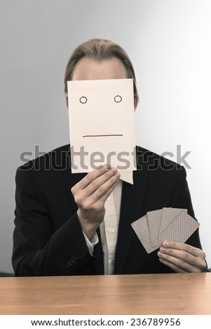 Business man with poker face - stock photo