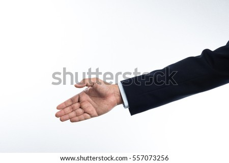 Business man with right hand reaching out for shake hands on white background