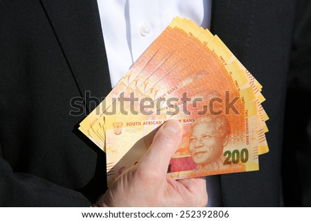 Business Man with South African Rand - stock photo