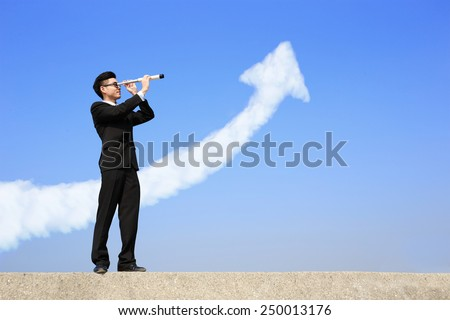 Business man with telescope ( spyglass ) looking forward with growth arrow cloud. a symbol of leadership, success and freedom. asian - stock photo
