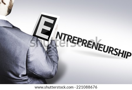 Business man with the text Entrepreneurship in a concept image - stock photo