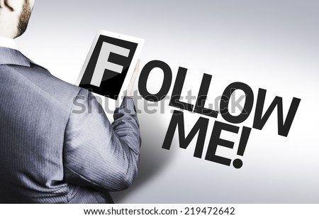 Business man with the text Follow Me in a concept image - stock photo