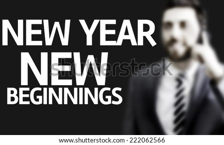 Business man with the text New Year New Beginnings in a concept image - stock photo