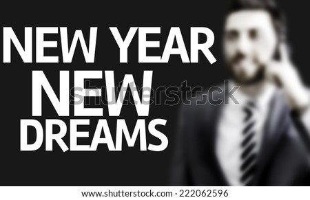 Business man with the text New Year New Dreams in a concept image - stock photo