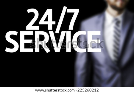 Business man with the text 24/7 Service in a concept image - stock photo