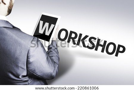 Business man with the text Workshop in a concept image - stock photo