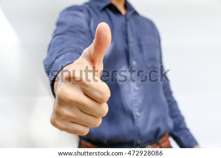 business man with thumb up hand sign can be use for empowerment and encouragement people.