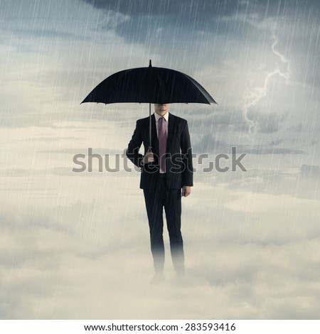 Business man with umbrella standing on the cloud with thunder. Business depression concept