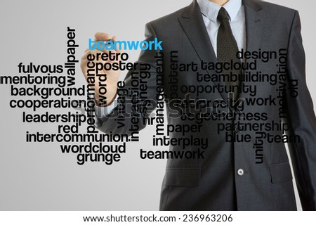 Business man with virtual interface of teamwork wordcloud