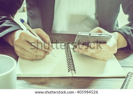 Business Man With Work In Morning And Mobile Phone (Vintage) - stock photo